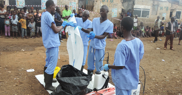 Health workers arrive and begin the process of donning their personal protective equipment. Photo: WHO/O. Kabia