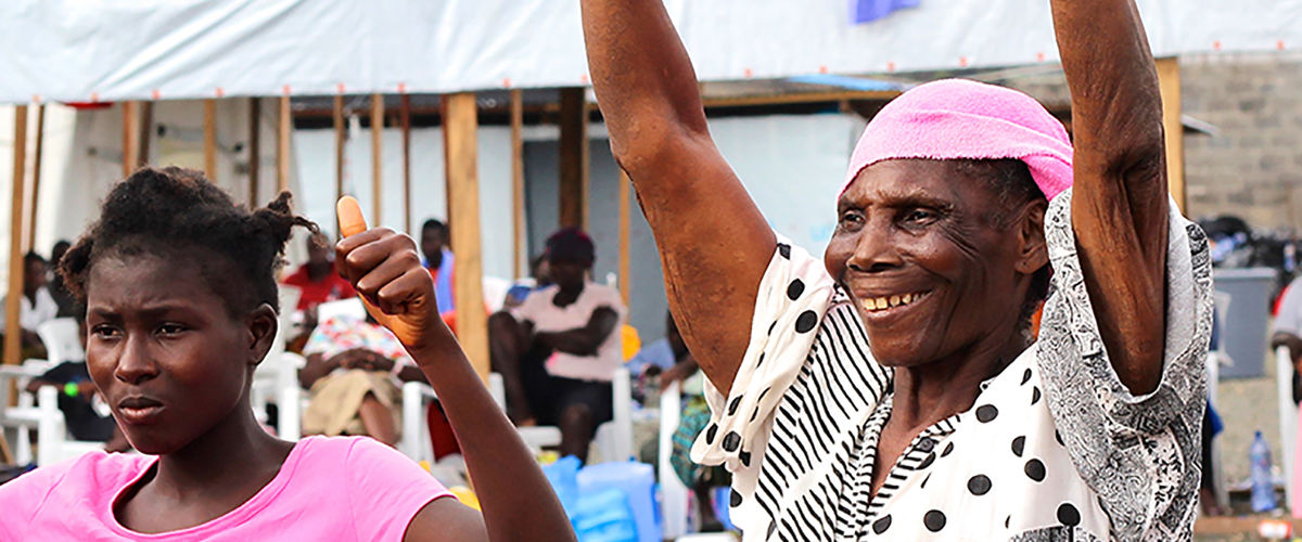 Survivors celebrate after being told they are free from Ebola at a treatment unit in Liberia. Photo: MSF